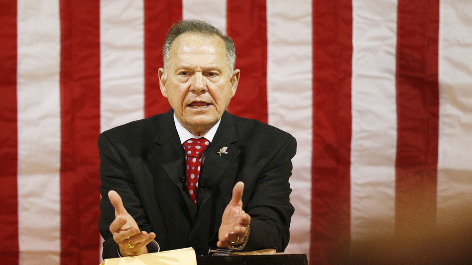 Former Alabama Chief Justice and U.S. Senate candidate Roy Moore speaks at a rally Thursday, in Dora, Ala.