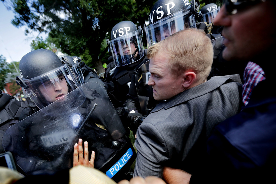 """White nationalists clash with police as they are forced out of Emancipation Park after the """"Unite the Right"""" rally Aug. 12 in Charlottesville, Va. (Chip Somodevilla/Getty Images)"""
