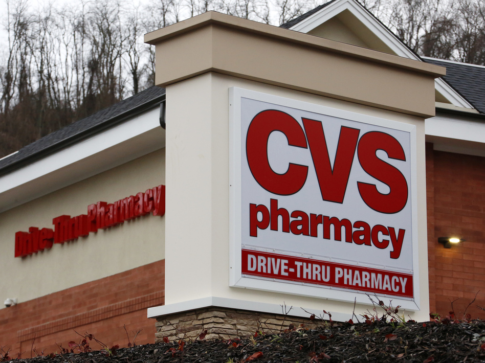 CVS Health has struck a deal to buy Aetna, the insurance giant. The combined companies would have more clout with drugmakers and would aim to bring more health care to consumers in retail clinics. (Gene J. Puskar/AP)