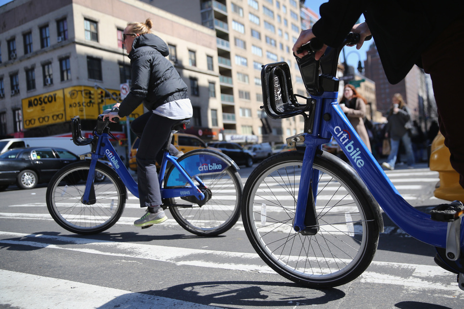 Citi Bike users pedal through the streets of Manhattan. Some members of Generation Z, the younger generation following the millennials, are less inclined to own cars and lean more toward bike-sharing and ride-sharing services. (John Moore/Getty Images)