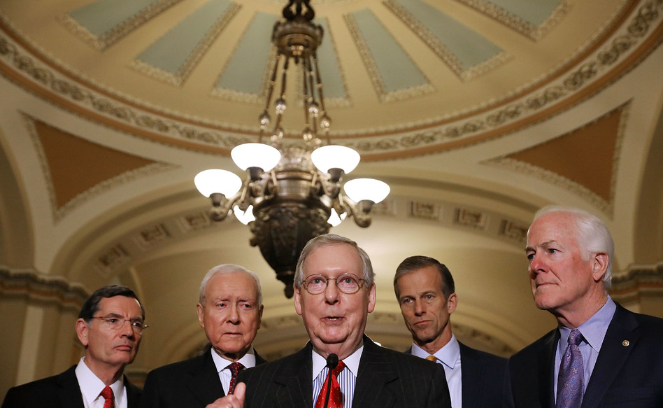 Senate Majority Leader Mitch McConnell, R-Ky. (center), gathered the support he needed on Friday to pass the GOP tax bill in the Senate. Now that legislation must be reconciled with the House version. (Chip Somodevilla/Getty Images)