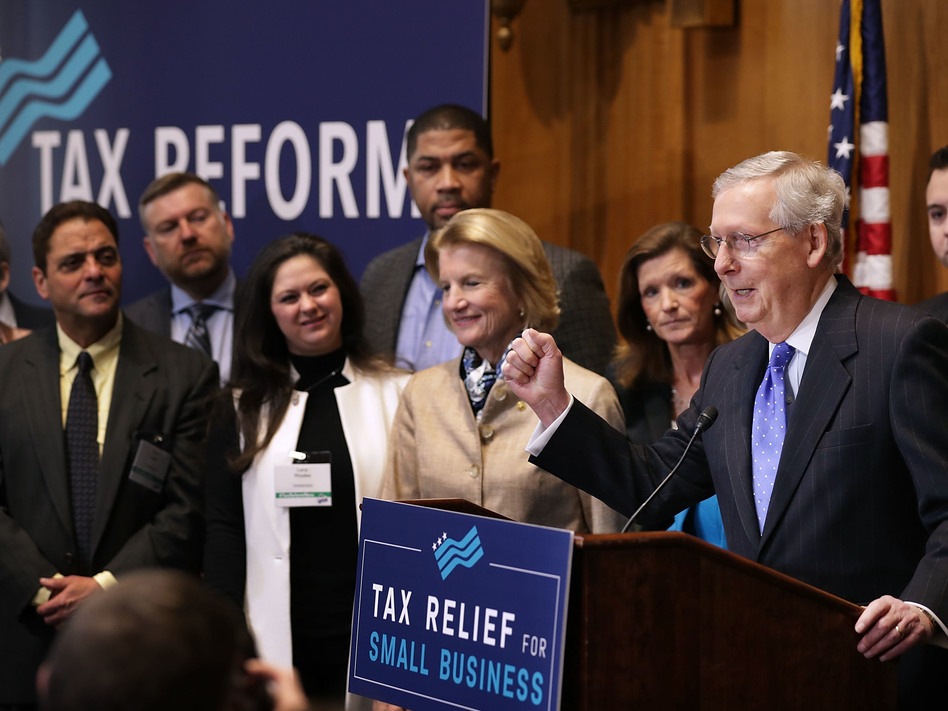 Senate Majority Leader Mitch McConnell addressed a tax reform news conference on Capitol Hill last Thursday, alongside Sen. Shelley Moore Capito of West Virginia and representatives of small-business groups. (Chip Somodevilla/Getty Images)