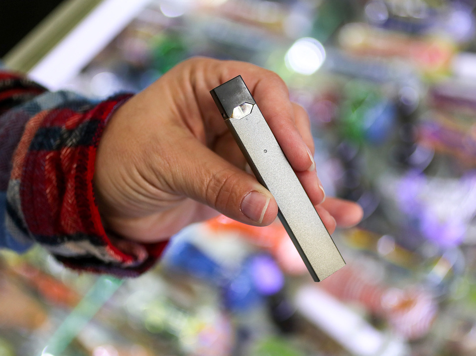 A JUUL e-cigarette for sale at Fast Eddie's Smoke Shop in Boston. The sleek devices are easy to conceal, which makes them popular with teenagers. (Suzanne Kreiter/The Boston Globe via Getty Images)