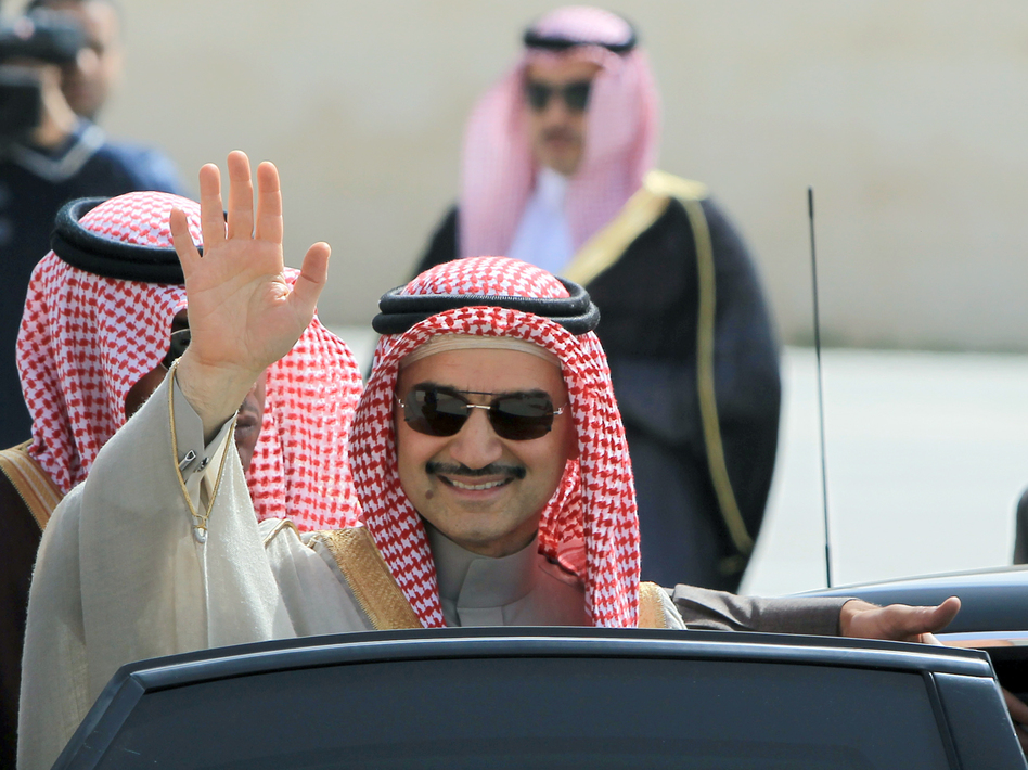Saudi Prince Alwaleed bin Talal waves during an official visit to the West Bank city of Ramallah in 2014. The Saudi billionaire was detained last month in Riyadh and has not been seen since. (Abbas Momani/AFP/Getty Images)