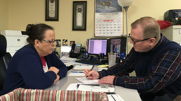 David Ermold (right) files to run for Rowan County Clerk as Kim Davis looks on, two years after Davis denied Ermold and his now-husband a marriage license because she was opposed to gay marriage.