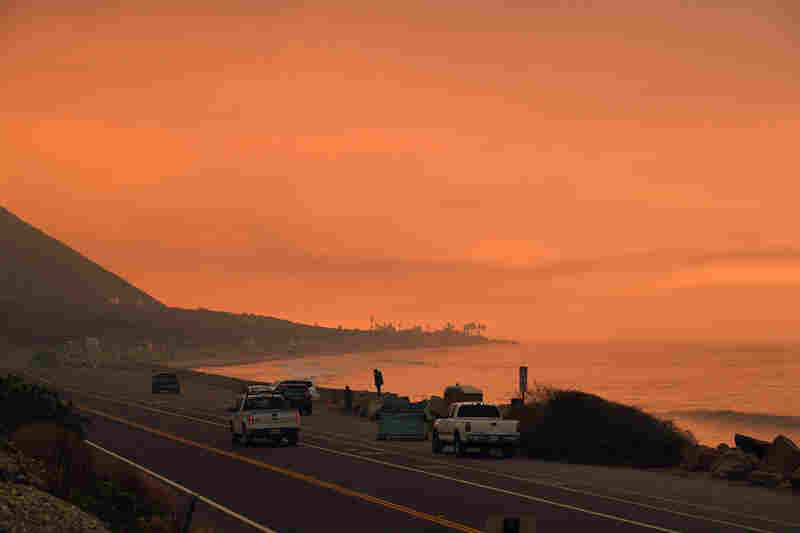 Heavy smoke covers the Pacific Coast Highway as flames reach the coast near Ventura, Calif., on Wednesday.
