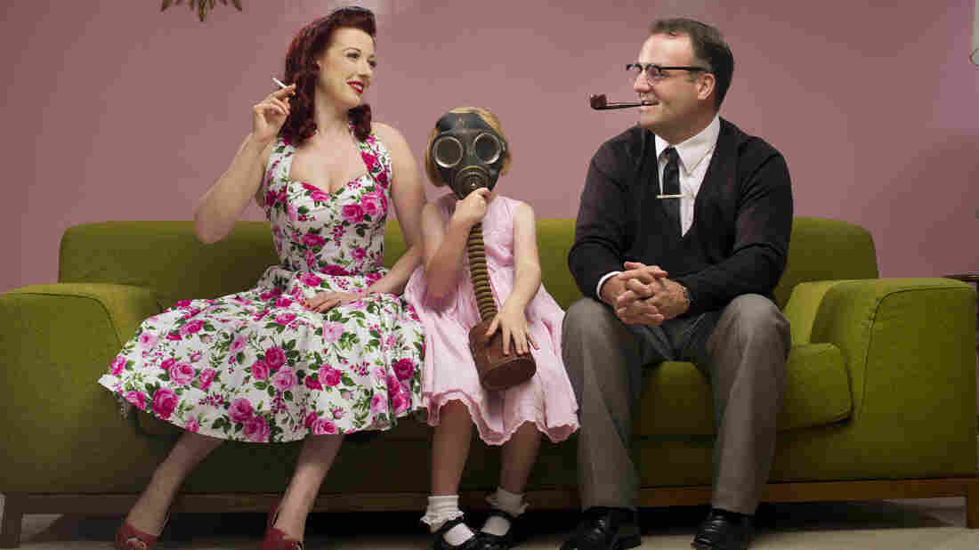 1950s retro family share the joy of smoking with their daughter