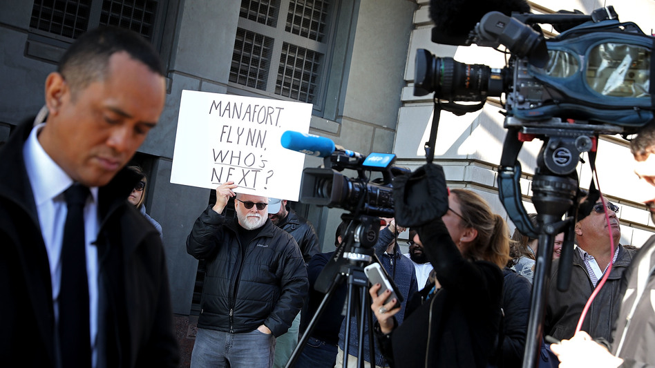 Protesters outside the federal courthouse where Michael Flynn pleaded guilty early this month speculate what is coming next in the special counsel probe. (Chip Somodevilla/Getty Images)
