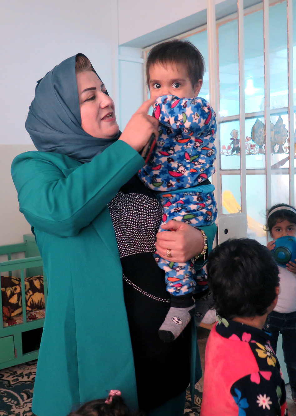The other children are either orphaned, abandoned or rescued from kidnappers. The woman is Sukaina Ali Younis, founder of the new orphanage and in charge of women's and orphans' affairs in Mosul's Ninevah governorate.