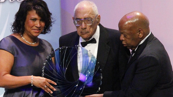 Journalist Simeon Booker, center, is presented with a Phoenix Award at the 2010 Congressional Black Caucus Foundation