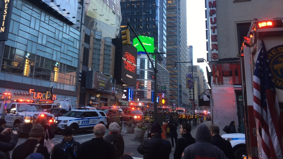 After an explosion a block away, police swarmed through Times Square in Midtown Manhattan. (Amita Kelly/NPR)