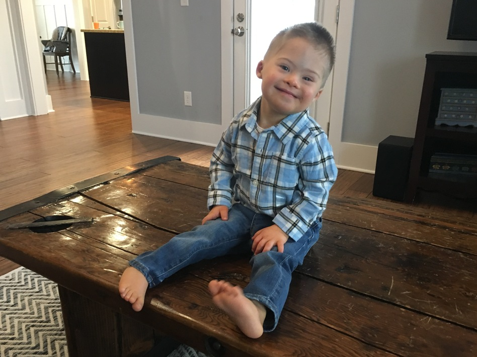 "Kelly Kuhns's 2-year-old son Oliver was born with Down syndrome. She says that she was shocked when a prenatal test revealed a Trisomy 21 mutation. But, she says, ""he's still a baby. He's still worthy of a life just like everybody else."" (Sarah McCammon/NPR)"