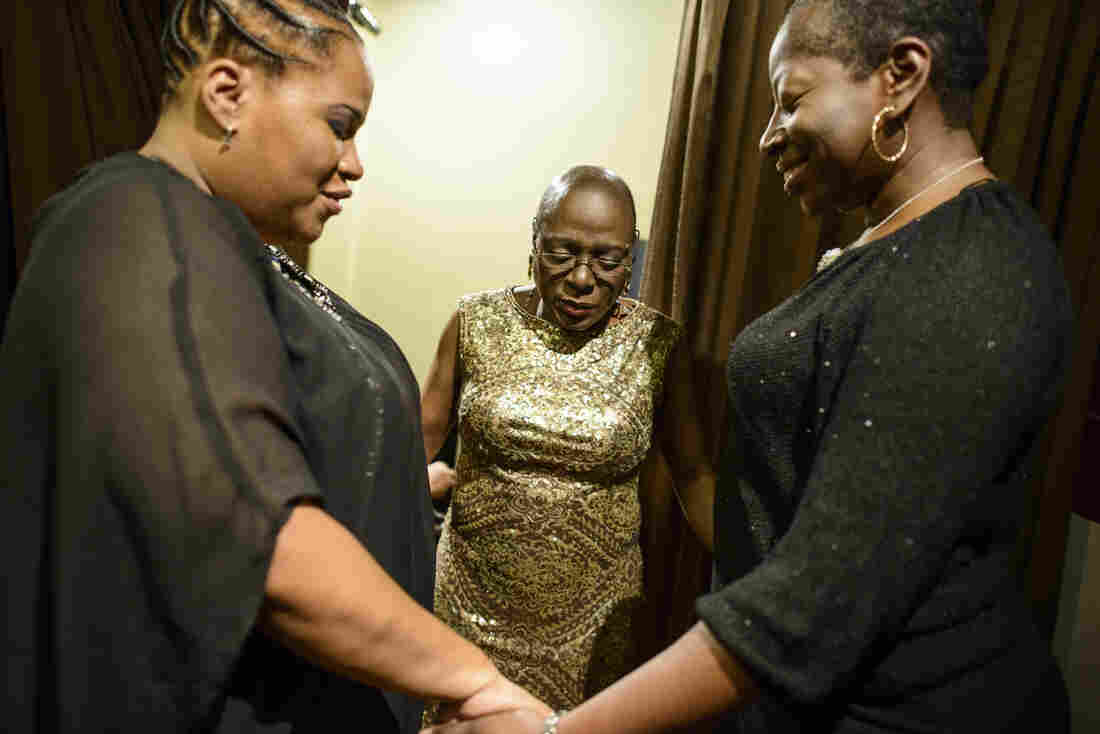 Beacon Theater, February 2014 - I didn't really know about Sharon's spiritual dimension until the time of this picture. I learned that leading up to a performance, Starr Duncan (left) and Saundra Williams (right) would often say a prayer together with Sharon, which was an important part of focusing the emotional energy that she would bring to her performances.