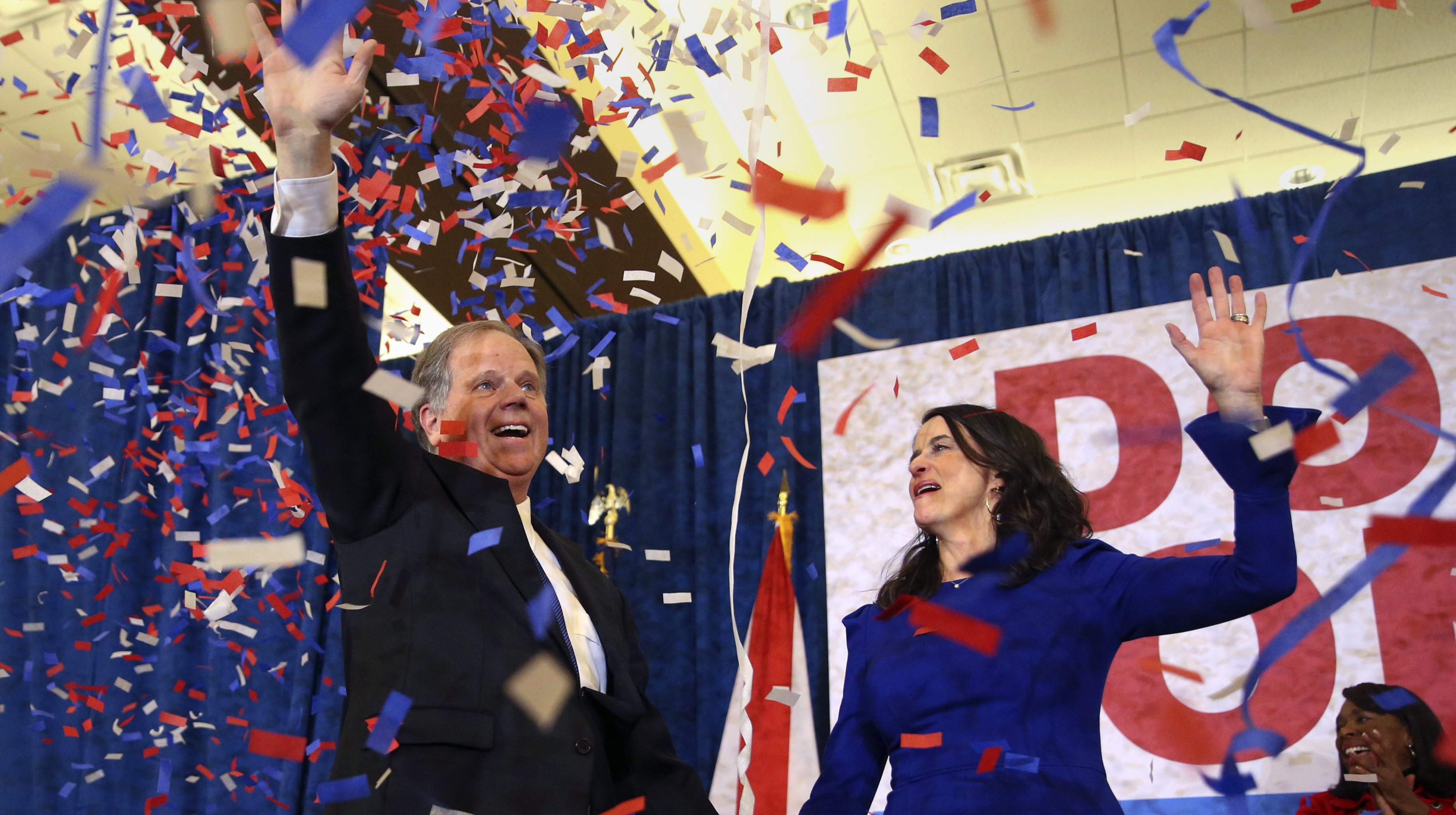 Democratic candidate for Senate Doug Jones and his wife, Louise, wave to supporters before he gave his victory speech in Birmingham, Ala., on Tuesday.