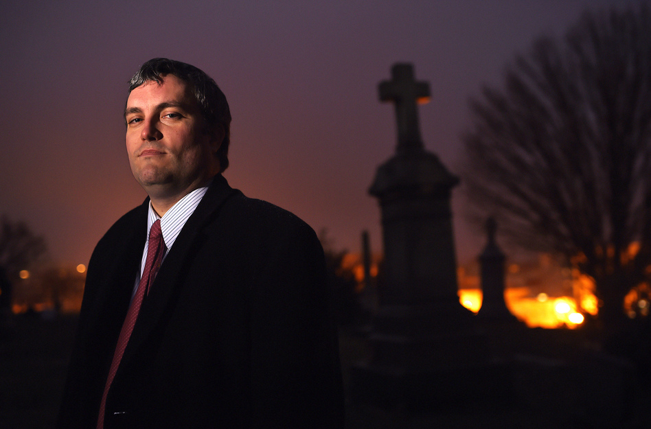 "Brett Talley stands in Holy Rood Cemetery in Washington, D.C., in 2014. Talley had been rated ""unanimously unqualified"" for a lifetime judicial appointment and his nomination ""will not be moving forward,"" according to a Trump administration official. (Matt McClain/The Washington Post via Getty Images)"