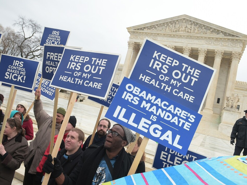 Opposition to Obamacare has been strong from the beginning. Demonstrators made their dissatisfaction clear in front of the Supreme Court in 2015. (Mandel Ngan/AFP/Getty Images)