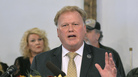 Kentucky state Rep. Dan Johnson committed suicide on Wednesday following a report alleging that he sexually assaulted a girl in January 2013. He is pictured here at his Louisville church on Tuesday. Behind him is his wife, Rebecca, who says she plans to run for his seat.