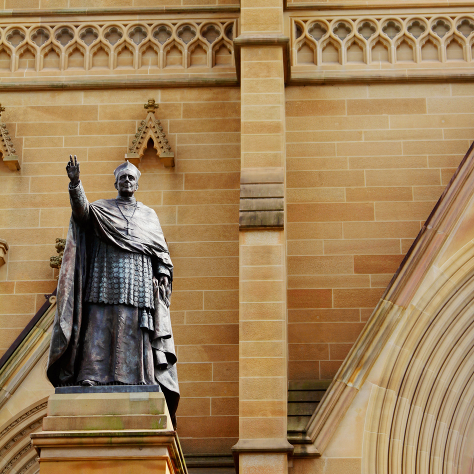 The bronze statue of Cardinal Moran stands by the entrance of St. Mary's Cathedral, in Sydney, Australia. (Nina Dermawan#145440/Moment Editorial/Getty Images)