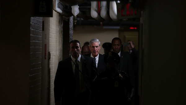 Special counsel Robert Mueller (C) leaves after a closed meeting with members of the Senate Judiciary Committee on June 21, 2017, at the Capitol in Washington, D.C.