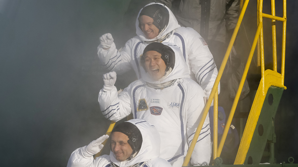Russian cosmonaut Anton Shkaplerov, (bottom); Japanese astronaut Norishige Kanai, middle; and U.S. astronaut Scott Tingle, above; wave prior to the launch of the Soyuz-FG rocket at the Russian-leased Baikonur cosmodrome in Kazakhstan on Sunday.