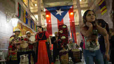 'We Feel Like Home': Displaced Puerto Ricans Celebrate Traditional Christmas Parranda