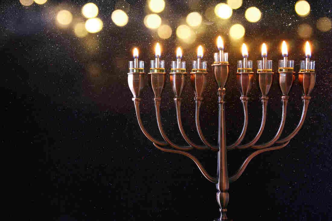 A Menorah and burning candles