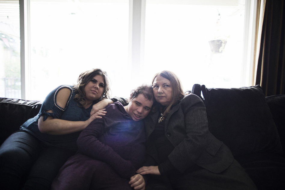 Patricia (from left), Natalie and their mother, Rosemary, sit in their home in Northern California. Natalie, a woman with an intellectual disability, is unable to speak. She couldn't explain what was wrong and doctors couldn't figure out why she was in pain. (Talia Herman for NPR)
