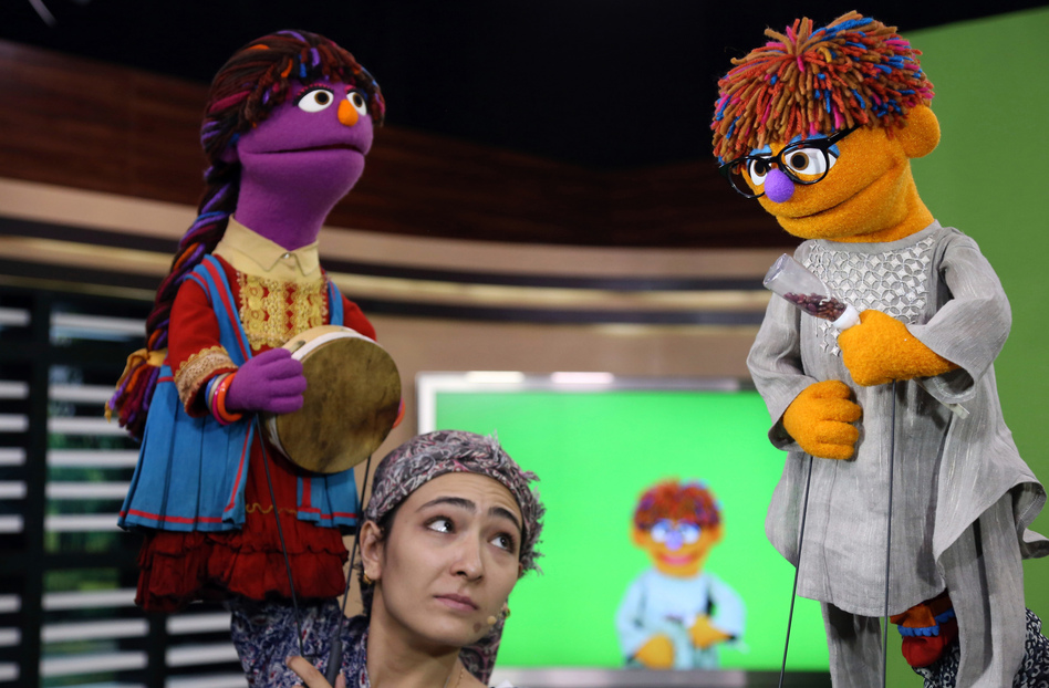 The MacArthur Foundation has awarded $100 million to Sesame Workshop and the International Rescue Committtee to create a version of Sesame Street aimed at Syrian refugee children. Above: Characters from the Afghani version of the show that premiered this year. (Rahmat Gul/AP)