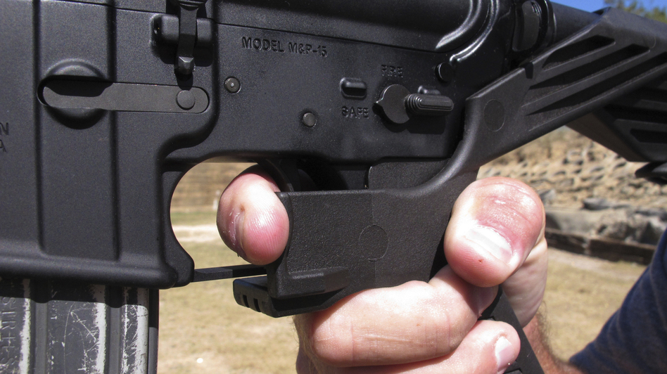 Bump stocks are now illegal to use in Columbia, S.C., after the city enacted a ban on the devices. In this photo from October, a shooting instructor shows the grip of an AR-15 rifle fitted with a bump stock. (Allen G. Breed/AP)
