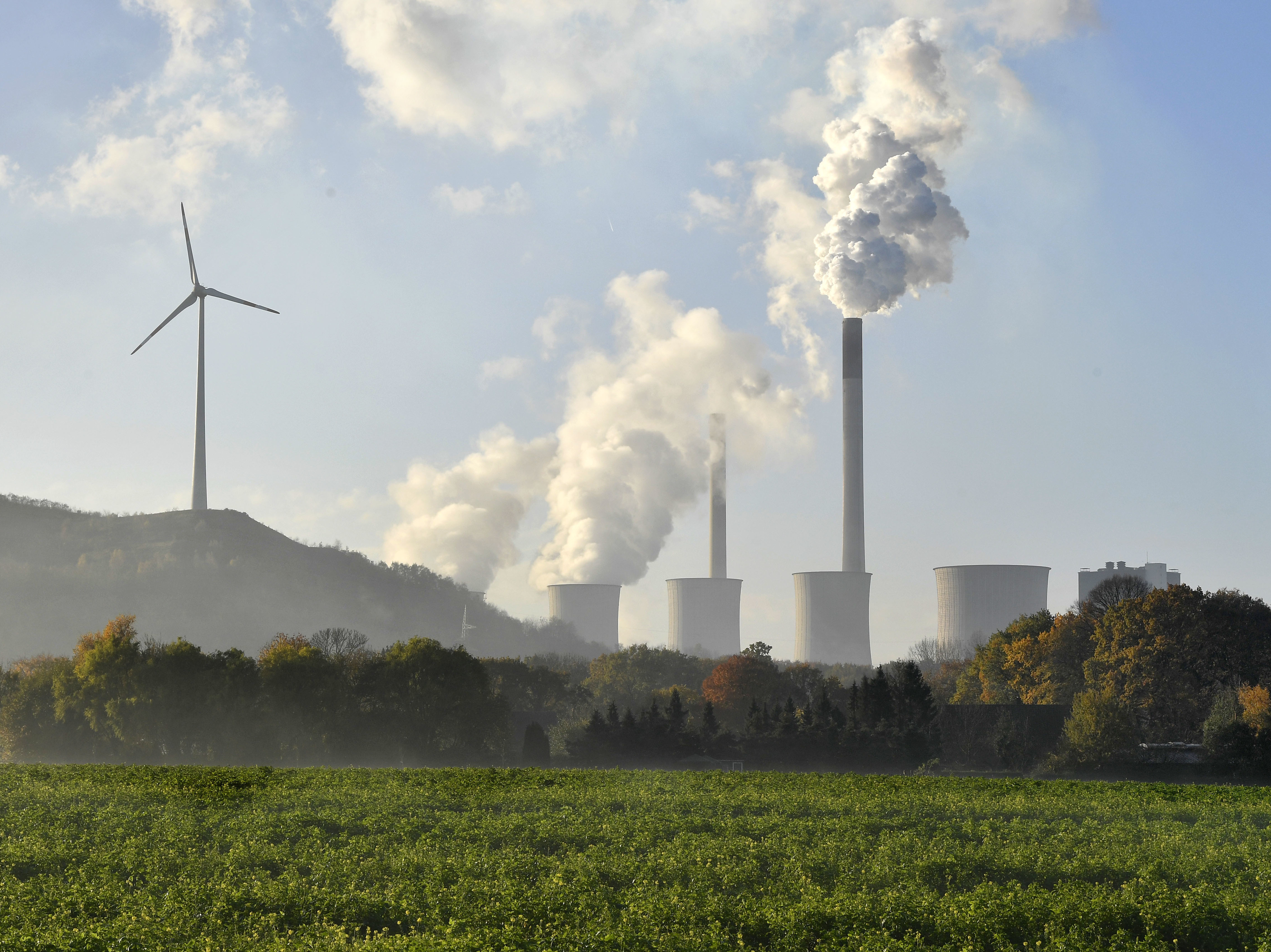 A coal-burning power plant steams in Gelsenkirchen, Germany, while the 23rd UN Conference of the Parties (COP) climate talks end in Bonn, Germany on Nov. 17, 2017.