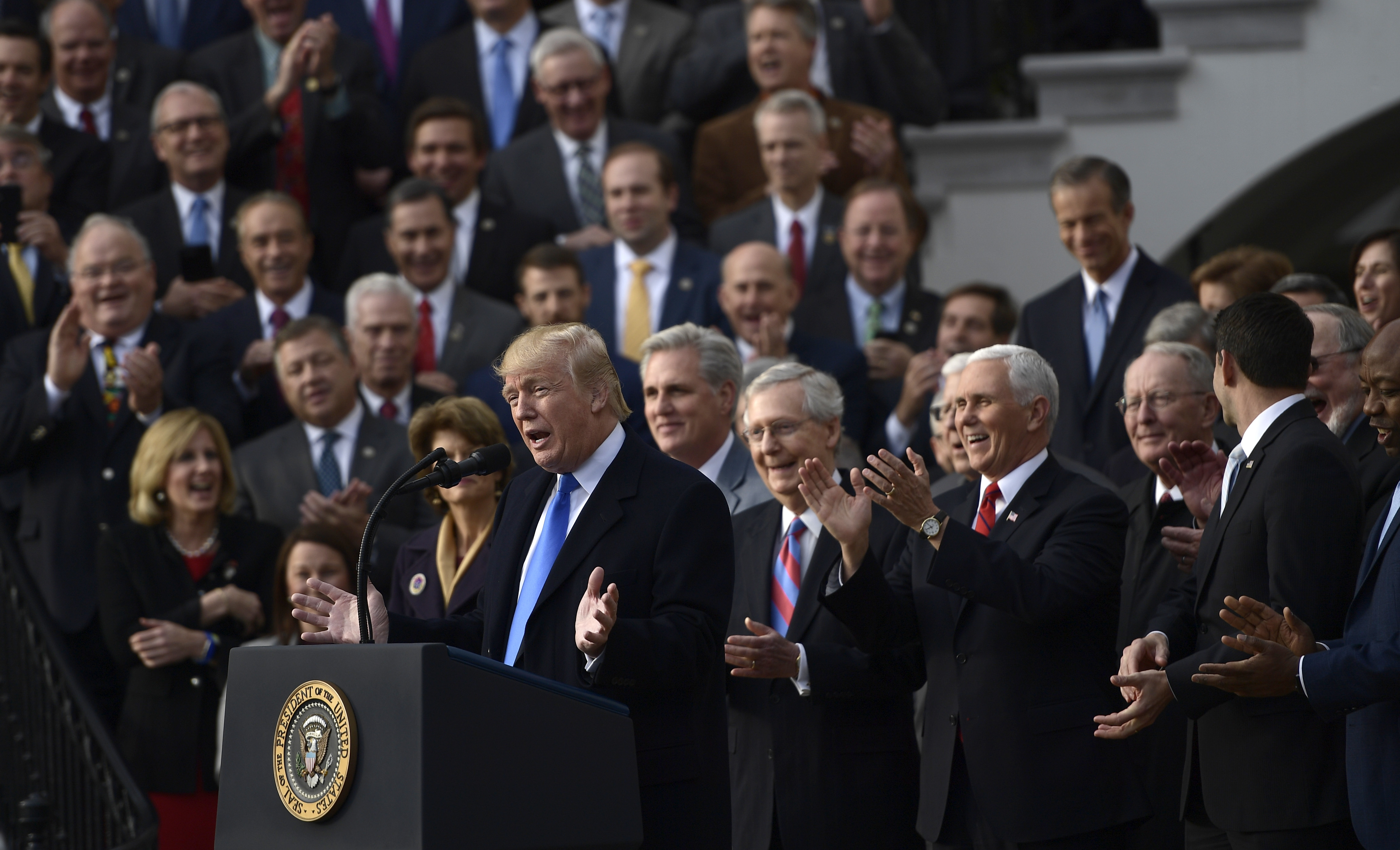 President Trump speaks about the passage of tax legislation on the South Lawn of the White House on Wednesday.