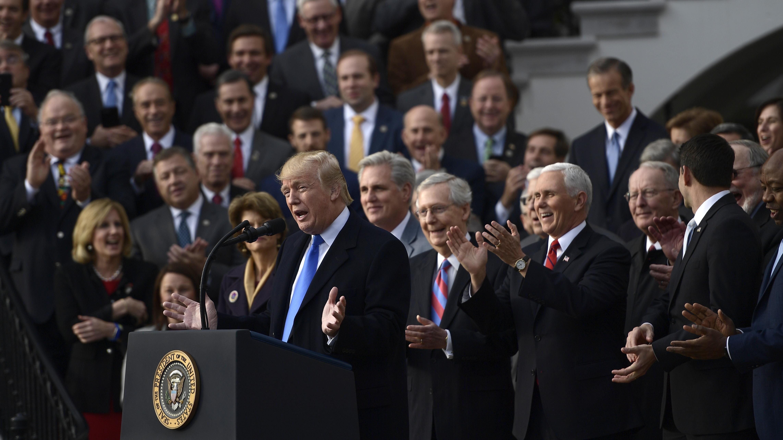 Trump signs tax overhaul, spending bill ahead of holidays