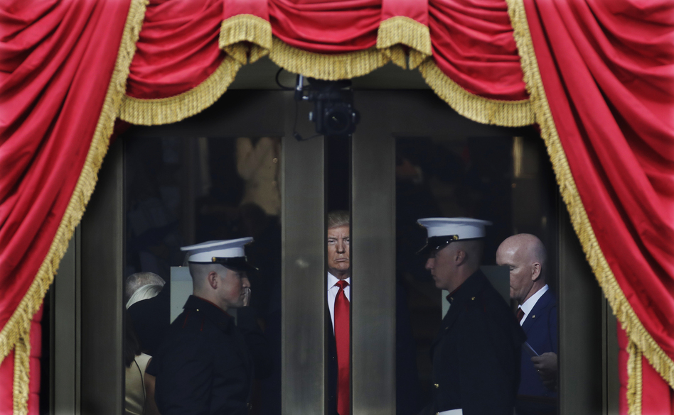 Donald Trump waits to step onto the portico for his presidential inauguration on Jan. 20.
