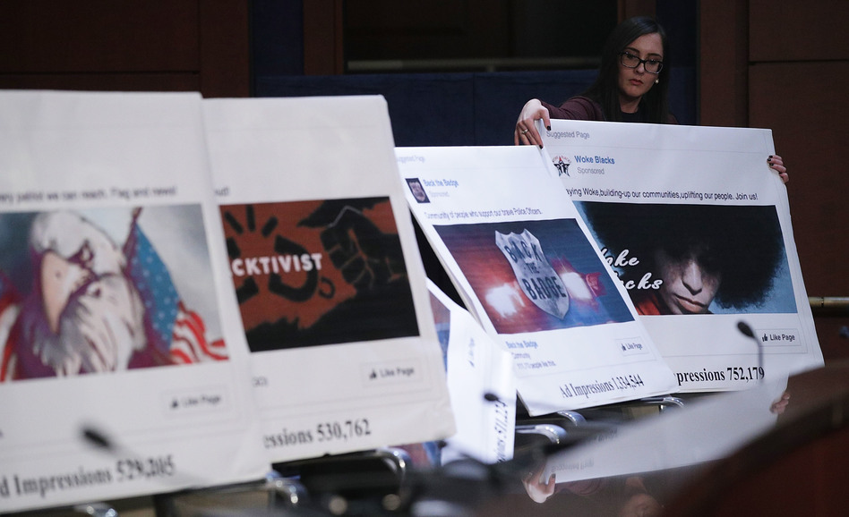 A congressional staff member displays images of social media posts during a House Intelligence Committee hearing in November about Russian use of social media.