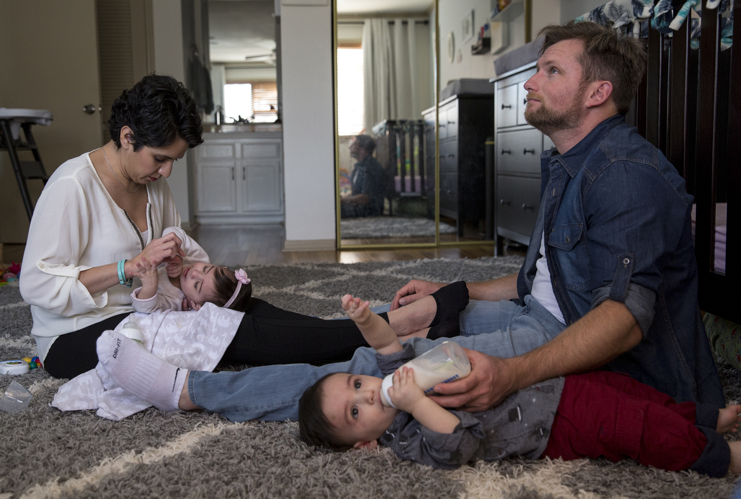Leah Bahrencu, 35, and her husband, Vlad Bahrencu, 37, feed their twins, Lukas and Sorana, at home in Austin.