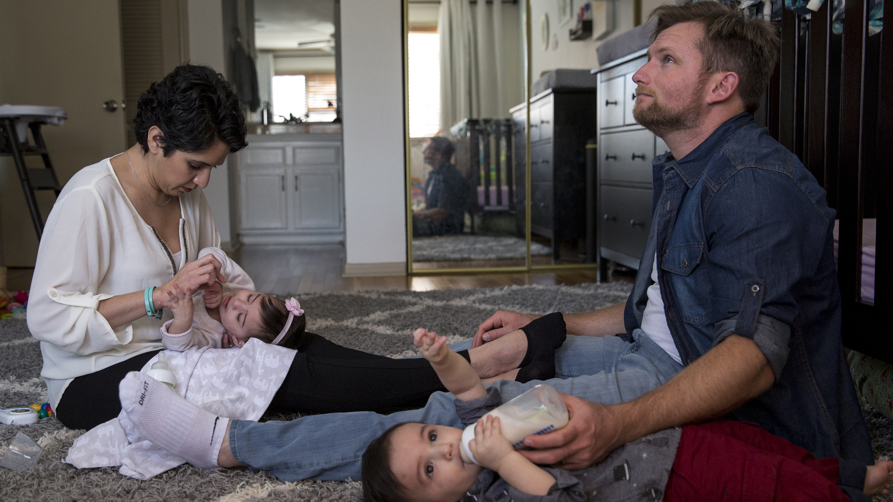 Leah Bahrencu, 35, and her husband, Vlad Bahrencu, 37, feed their twins, Lukas and Sorana, at home in Austin. (Ilana Panich-Linsman)