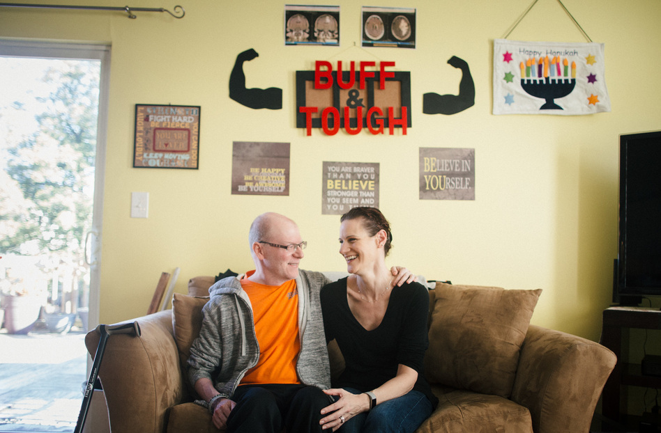 Ben and Tara Stern relax at home in Essex, Md. Ben was diagnosed with glioblastoma in 2016. After conventional treatment failed to stop the tumor, Ben tried an experimental drug. (Meredith Rizzo/NPR)