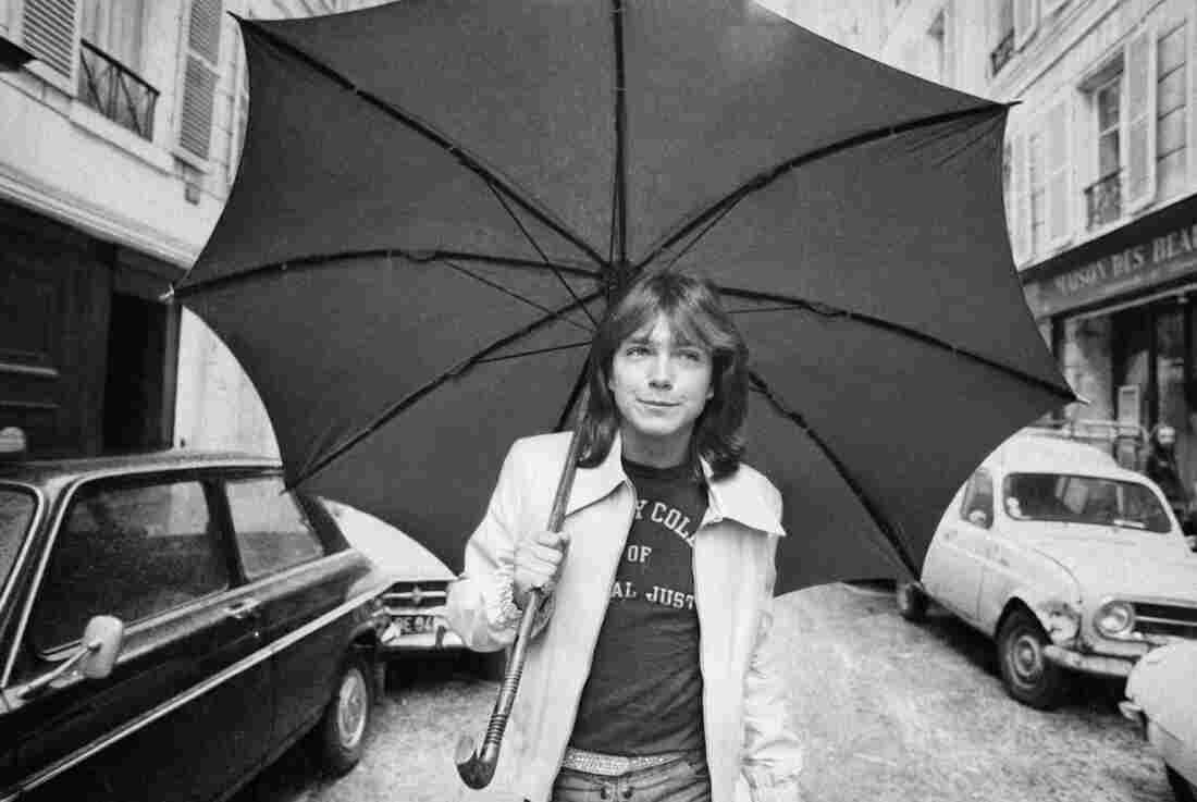 David Cassidy, American pop singer and star of the television program The Partridge Family, walks down a road in Paris in 1974.