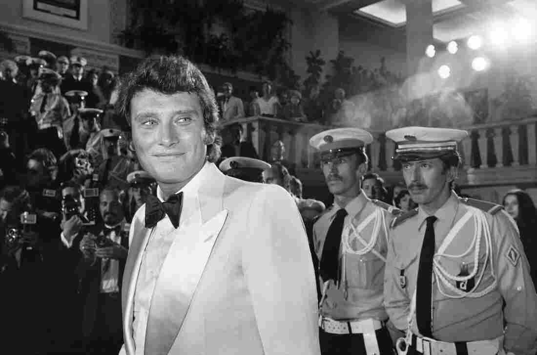 "French singer Johnny Hallyday arrives at the Cannes Film Festival in Cannes, France in 1976. Hallyday was known as the ""French Elvis."""