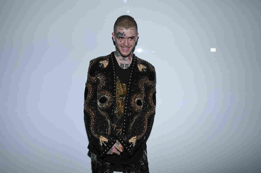 Lil Peep attends the Balmain Menswear Spring/Summer 2018 show as part of Paris Fashion Week on June 24.