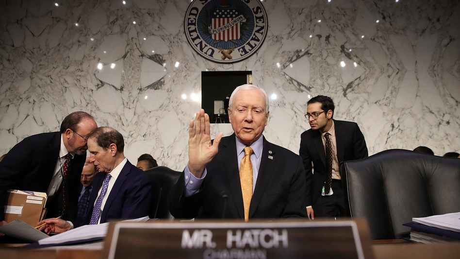 Senate Finance Committee chairman Orrin Hatch (R-Utah) gestures before a committee meeting on Nov. 15 in Washington, D.C. (Win McNamee/Getty Images)