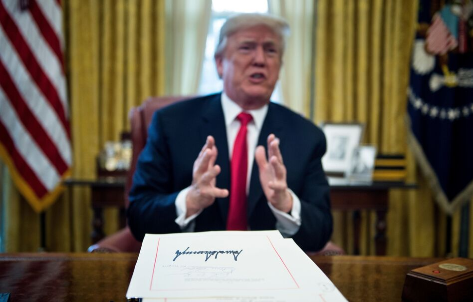 President Trump speaks about the Republican tax bill after signing it into law in the Oval Office on Dec. 22. Trump has signed 96 laws this year. (Brendan Smialowski/AFP/Getty Images)