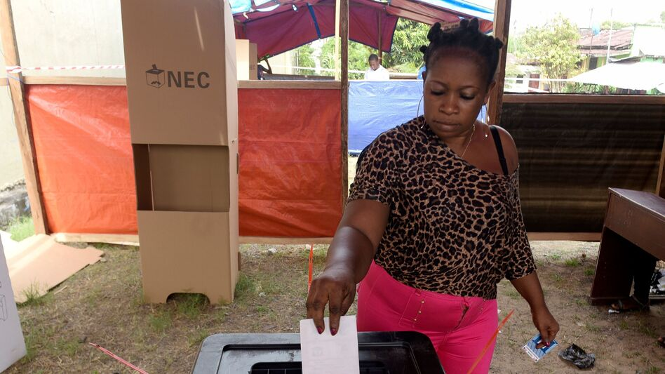 A woman casts her ballot at a polling station in Monrovia, Liberia, as Liberians go to the polls for the second round of presidential elections on Tuesday. (Seyllou/AFP/Getty Images)