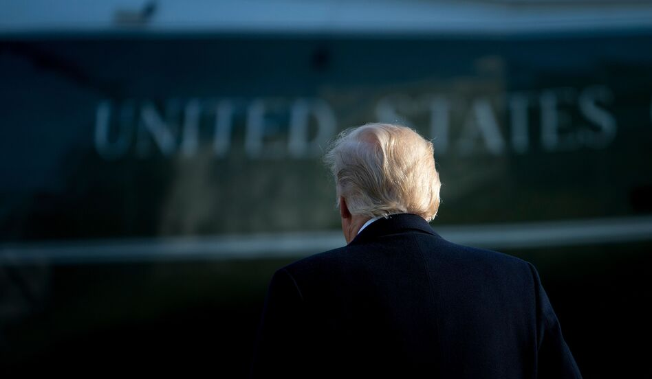 President Trump walks to Marine One on the South Lawn of the White House on Dec. 21, a day after signing the Republican tax bill. (Brendan Smialowski/AFP/Getty Images)