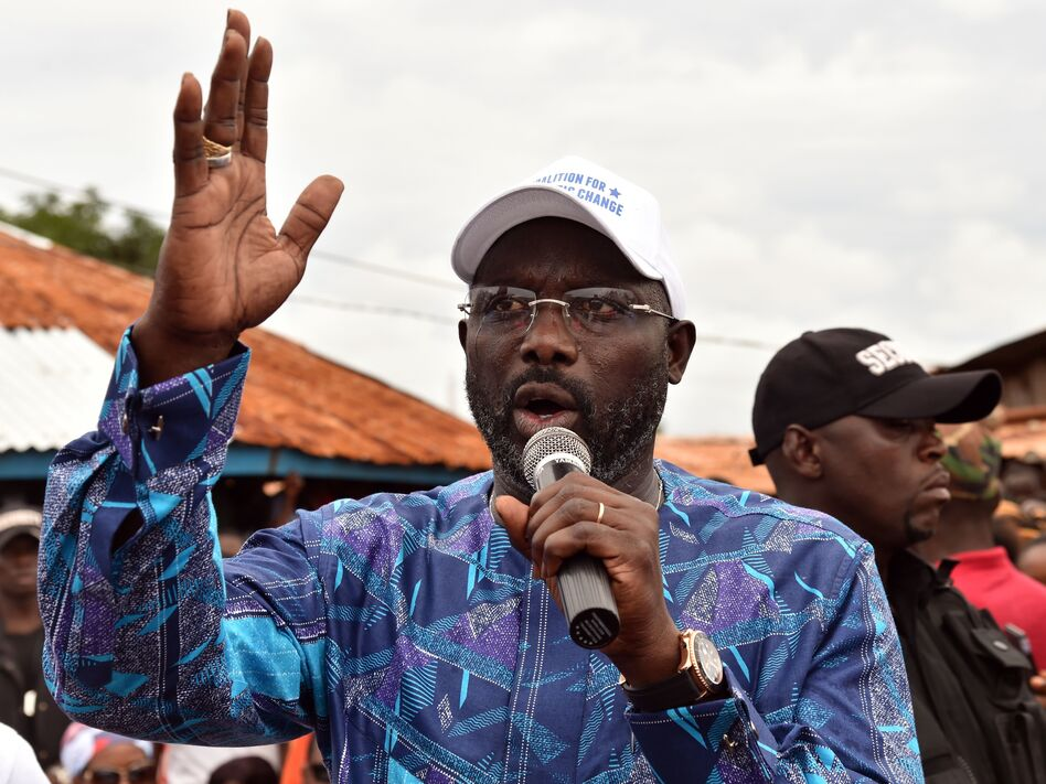 Liberian election officials said Thursday that soccer great George Weah, seen addressing an October campaign rally in Monrovia, had won the presidential runoff. (Issouf Sanogo/AFP/Getty Images)