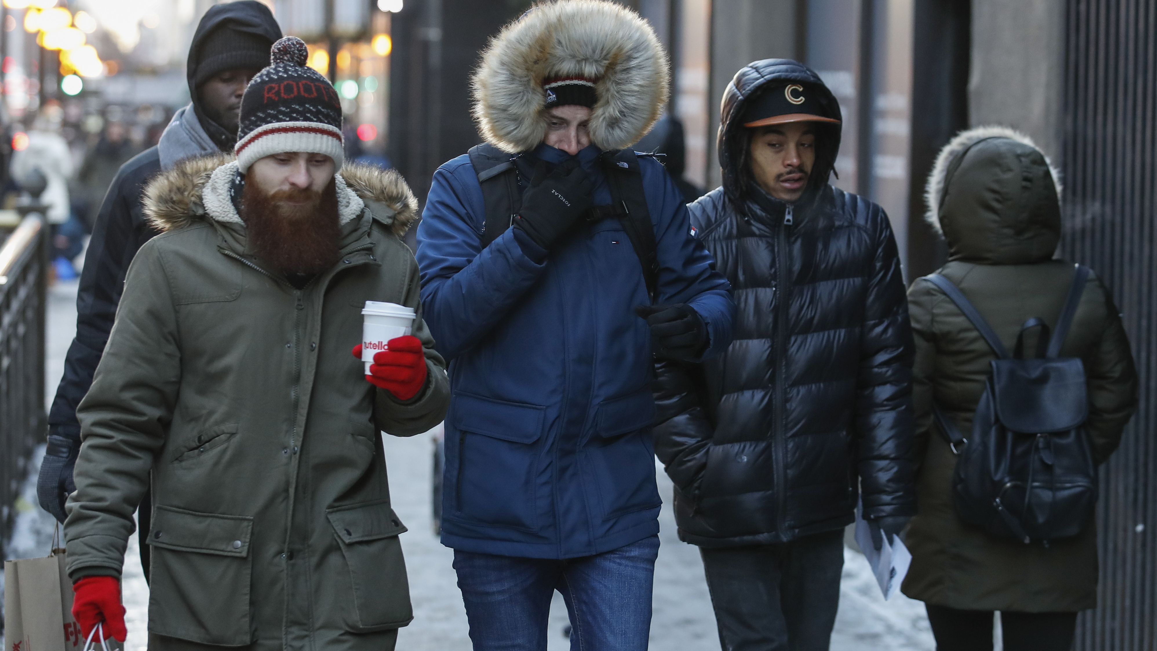 Pedestrians walk along Michigan Avenue in Chicago this week. Bitter cold is hitting much of the Northern half of the U.S., with temperatures dipping into the single digits and below zero. The extremely frigid weather is expected to last for days.