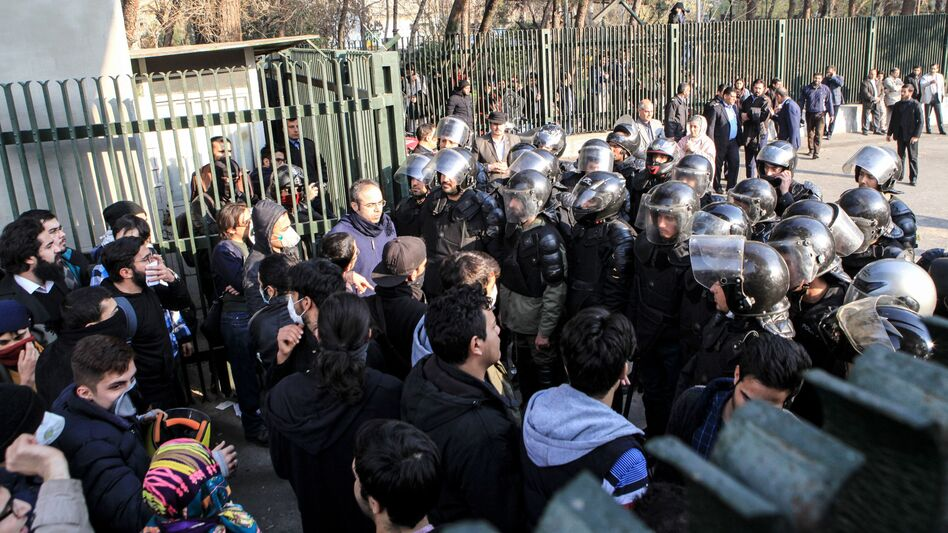 Iranian students scuffle with police at the University of Tehran on Saturday during a demonstration driven by anger over economic problems.