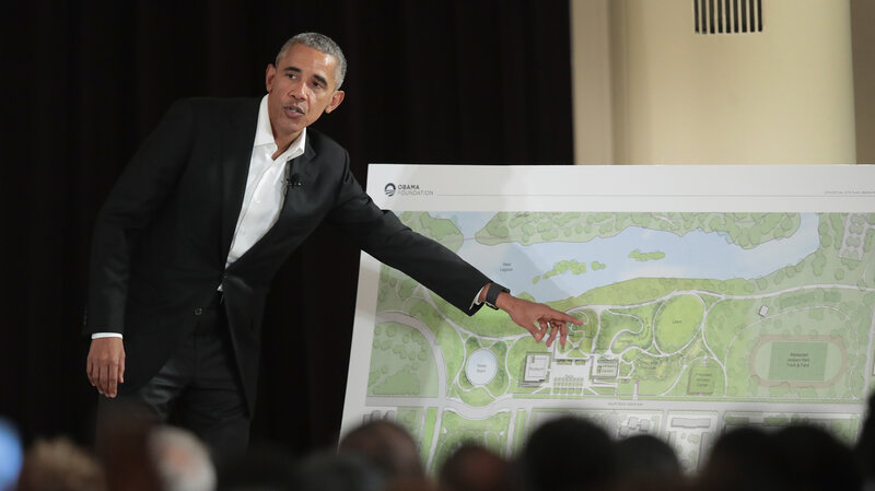 At a ceremony last May, former President Obama points out features of his proposed presidential center, which is scheduled to be built in Chicago. It is not the only honor that awaits the former president in the state he served as a senator: He's also getting a day designated in his honor. (Scott Olson/Getty Images)