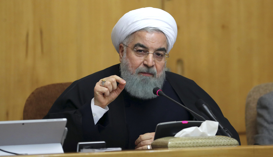 "Iranian President Hassan Rouhani speaks in a cabinet meeting in Tehran on Sunday. After a wave of economic protests swept major cities, Rouhani said people have the right to protest, but those demonstrations should not make the public ""feel concerned about their lives and security."""