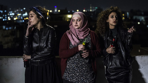 Salma (Sana Jammelieh), Nur (Shaden Kanboura) and Laila (Mouna Hawa) share a quiet moment In Between.